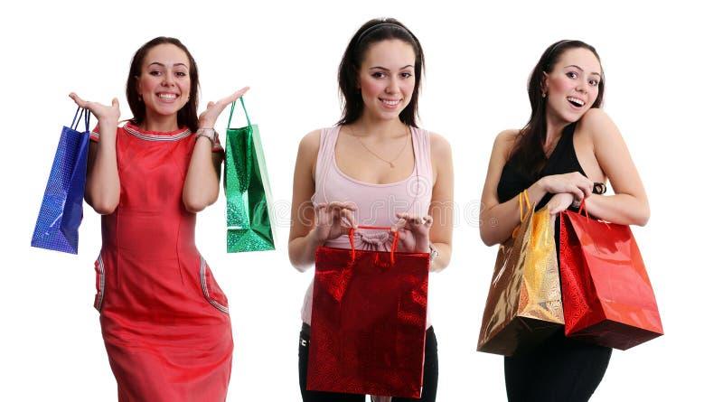 Коллаж - счастливые молодые женщины, изолированные на белизне стоковое фото rf