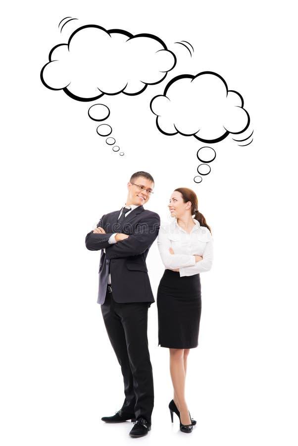 2 коллеги дела с думая облаками стоковые фото