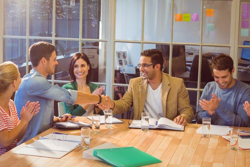 Коллеги используя компьтер-книжку на офисе стоковое фото rf