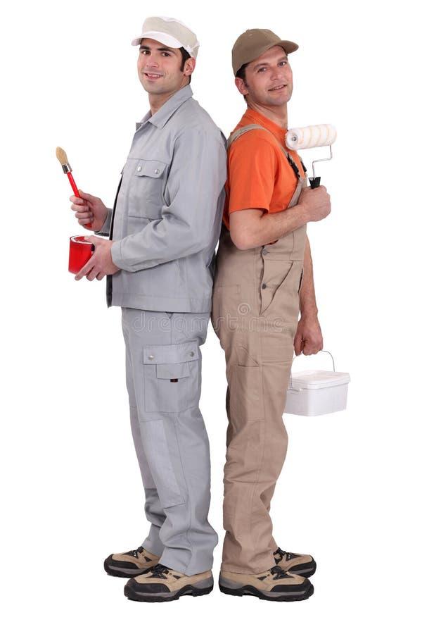 2 колеривщика спина к спине стоковое изображение