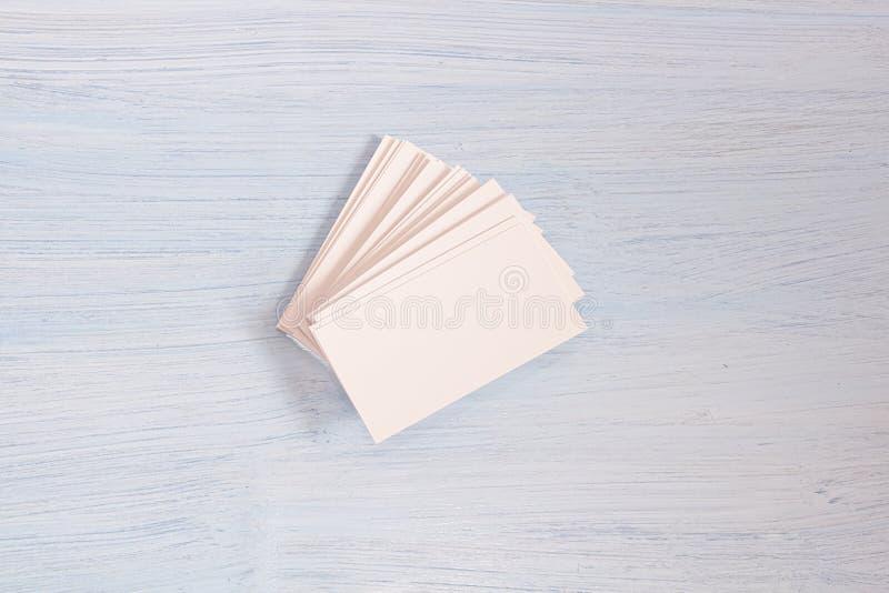 Колода карт лежит на голубой предпосылке стоковая фотография