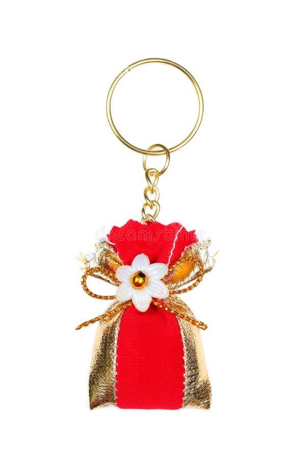 кольцо красной сумки ключевое изолированное на белизне стоковое фото