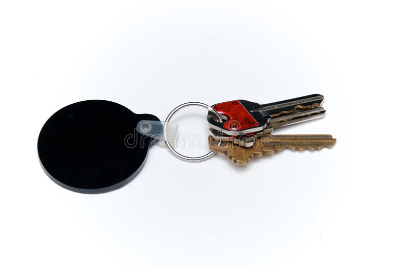 Кольцо для ключей с 3 ключами над белым и черным пробелом обманывает стоковое фото