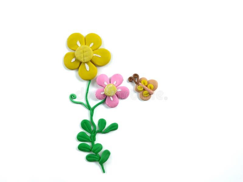 Красивая глина пластилина цветка цветеня, муха бабочки, милое естественное тесто стоковое фото rf