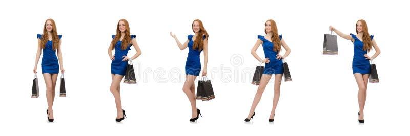 Красивая дама в темно-синем платье изолированном на белизне стоковые фотографии rf