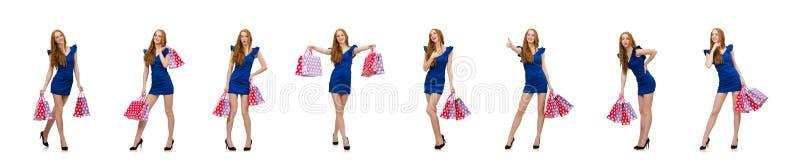 Красивая дама в темно-синем платье изолированном на белизне стоковая фотография