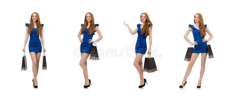 Красивая дама в темно-синем платье изолированном на белизне стоковое изображение