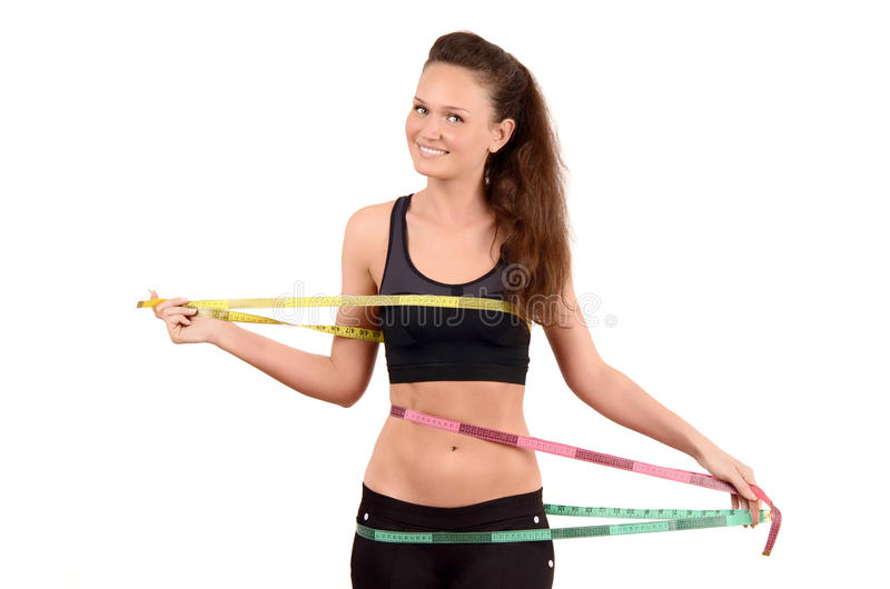 Красивая девушка пригонки измеряя ее бюст, талию и h стоковые фото
