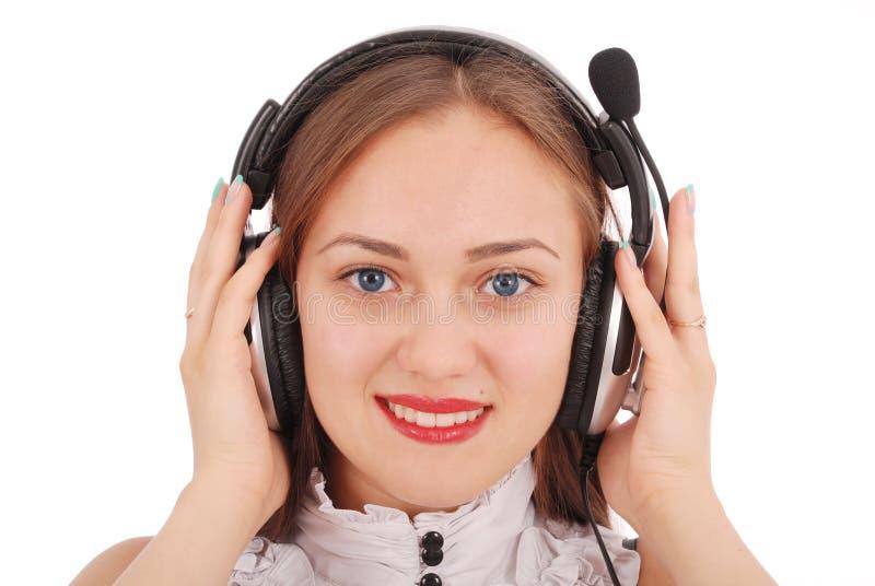 Красивая девушка студента оператора обслуживания клиента с headse стоковая фотография