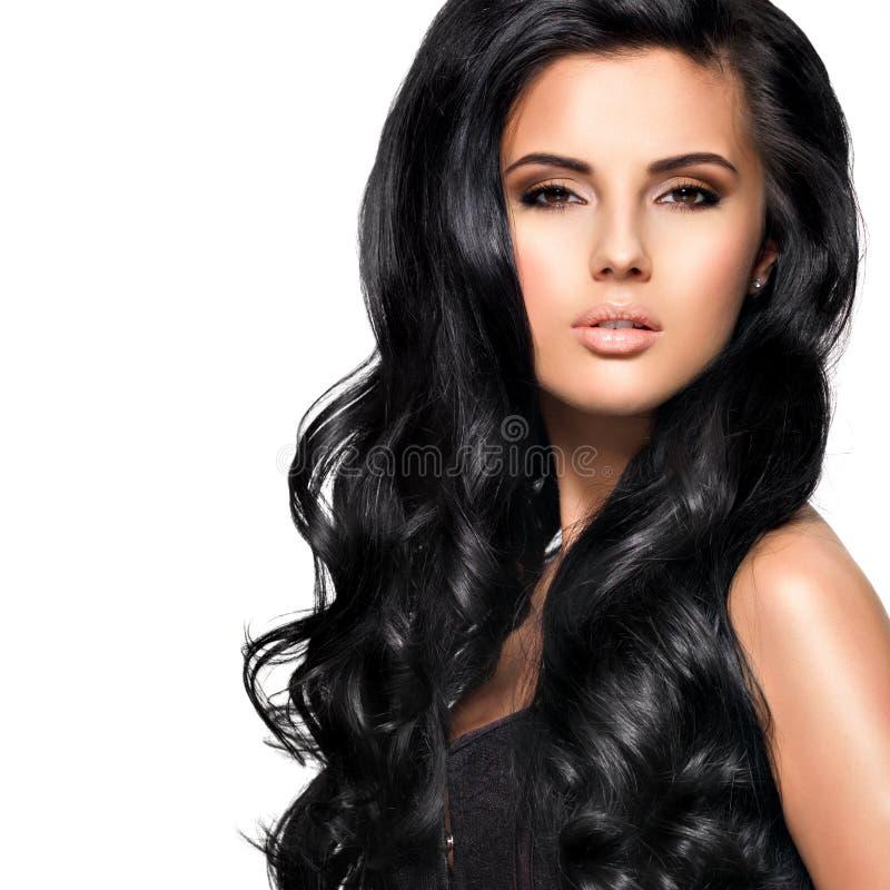 Красивая женщина брюнет с длинными черными волосами стоковое фото rf