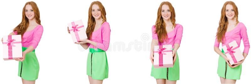 Красивая женщина в зеленой юбке с giftbox стоковое фото rf