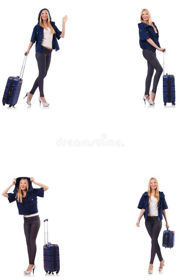 Красивая женщина с чемоданом в концепции каникул стоковое изображение