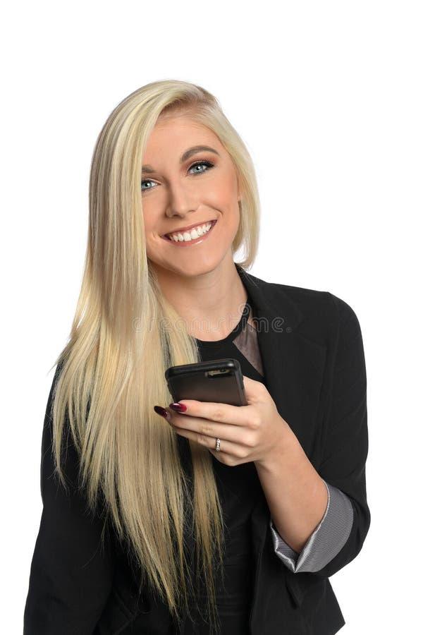 Красивая коммерсантка используя мобильный телефон стоковые изображения