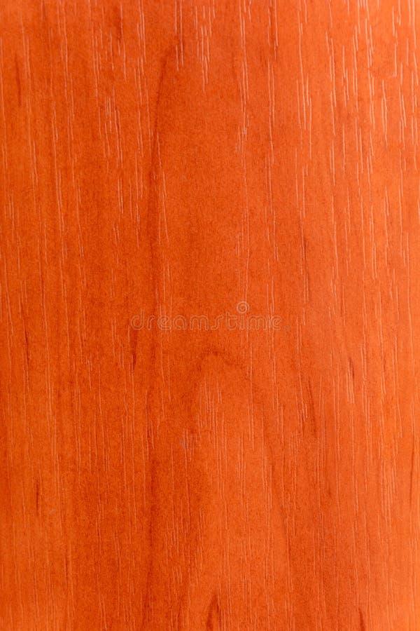 Красивая коричневая деревянная предпосылка на отлакированной текстурированной переклейке стоковое фото