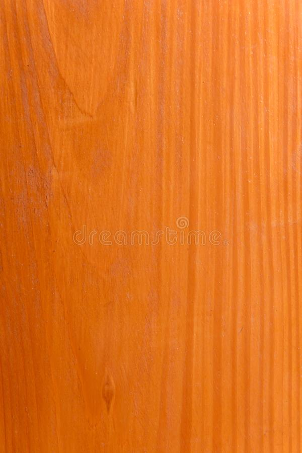 Красивая коричневая деревянная предпосылка на отлакированной текстурированной переклейке стоковые фото