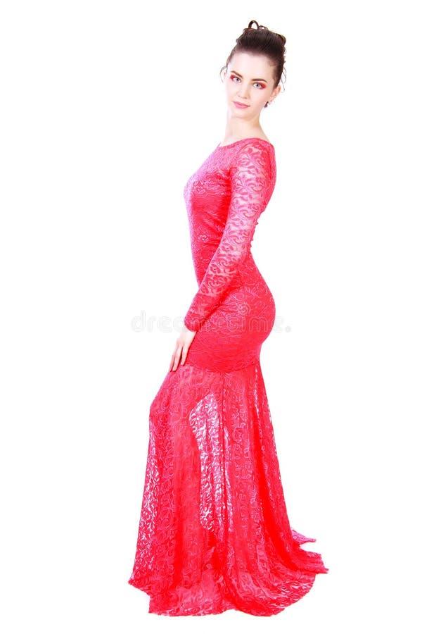 Красивая молодая женщина в красном платье вечера стоковое фото rf