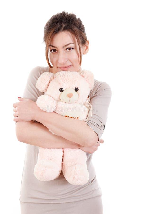 Красивая молодая женщина держа плюшевый медвежонка стоковая фотография rf