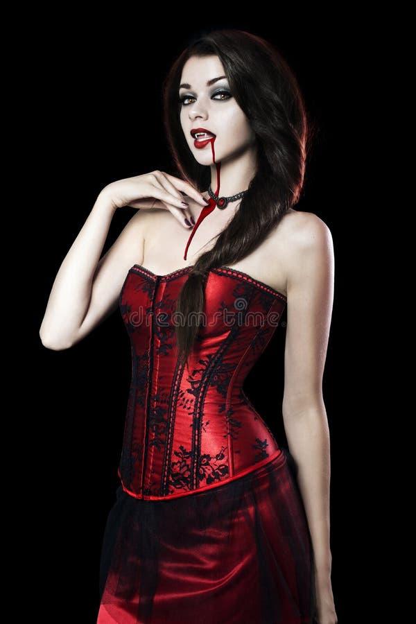 Красивая молодая женщина как сексуальный вампир стоковые изображения rf