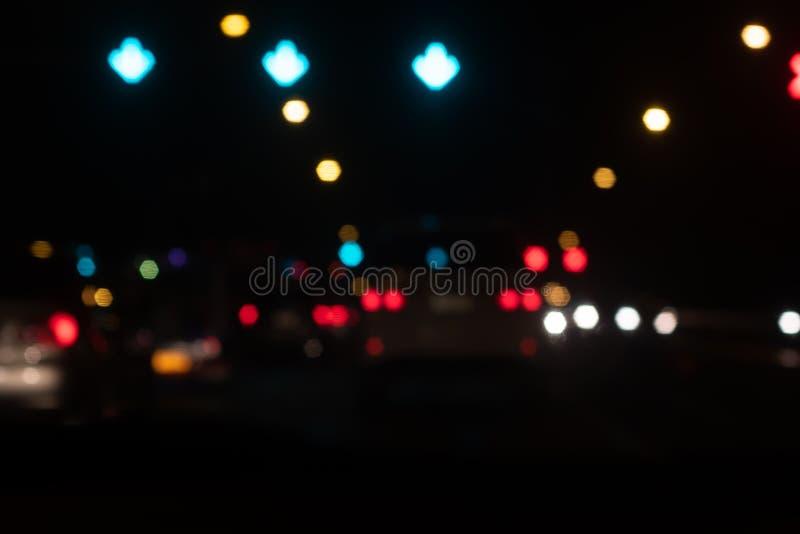 Красивая предпосылка bokeh нерезкости вечером Из фокуса движения стоковое фото rf