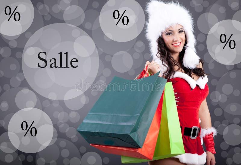 Красивая сексуальная девушка нося Санта Клауса одевает с сумкой цвета стоковые фото