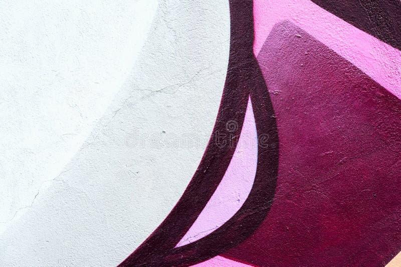 Красивая часть стены с деталью граффити, искусства улицы Абстрактные творческие цвета моды чертежа на городе стоковые фотографии rf