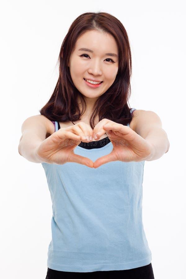 Красивейшая азиатская вскользь форма сердца выставки женщины. стоковые изображения rf