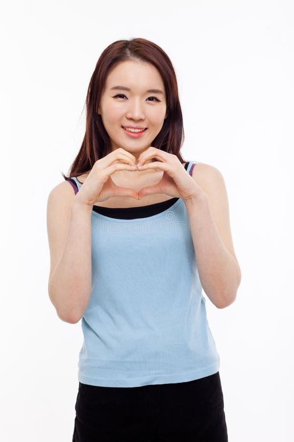 Красивейшая азиатская вскользь форма сердца выставки женщины. стоковая фотография rf