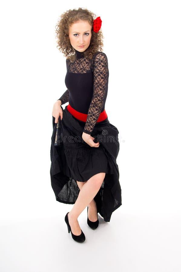 Красивейшая девушка с вентилятором и платьем танцует стоковое изображение