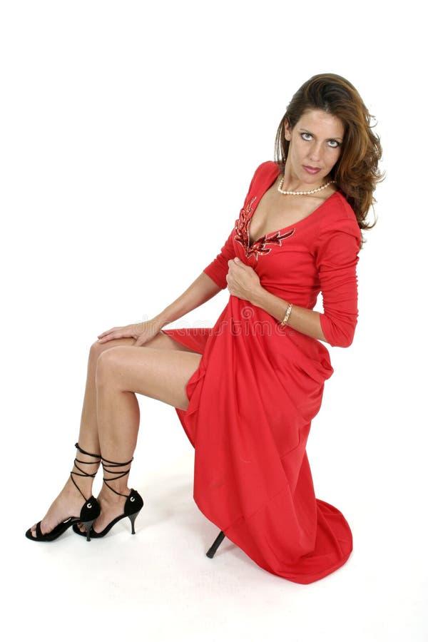 Красивейшая женщина в красном платье 4 стоковые фотографии rf