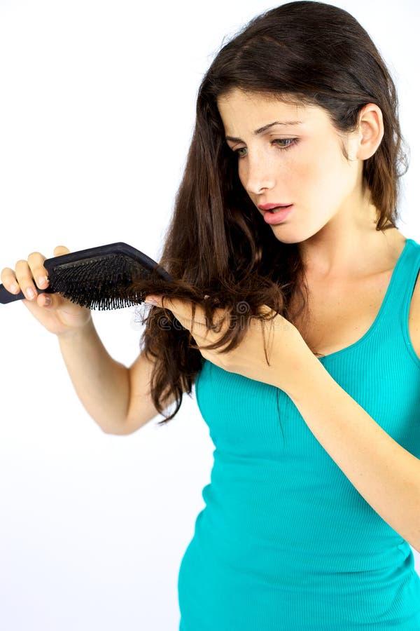 Красивейшая женщина несчастная о ее длинних волосах стоковые фото