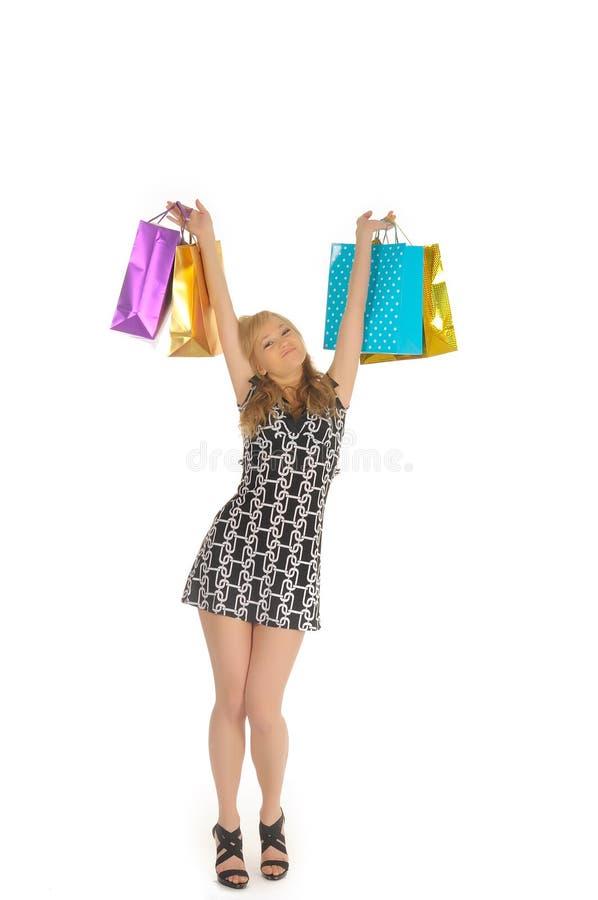 Красивейшая женщина с много хозяйственными сумками. изолировано на белизне стоковые фотографии rf