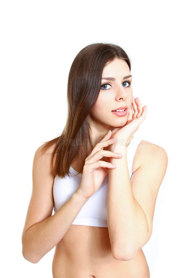 Красивейшая молодая женщина с здоровой чистой кожей стороны - isol стоковое изображение rf