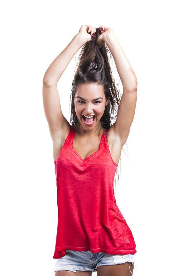 Женщина хватая ее волос стоковые изображения rf