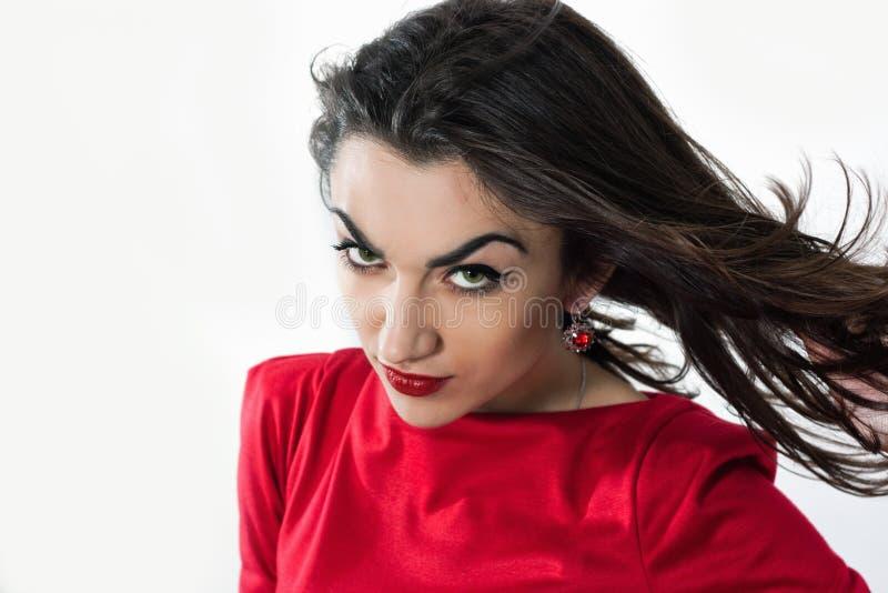 Женщина развевая ее волосы стоковые изображения