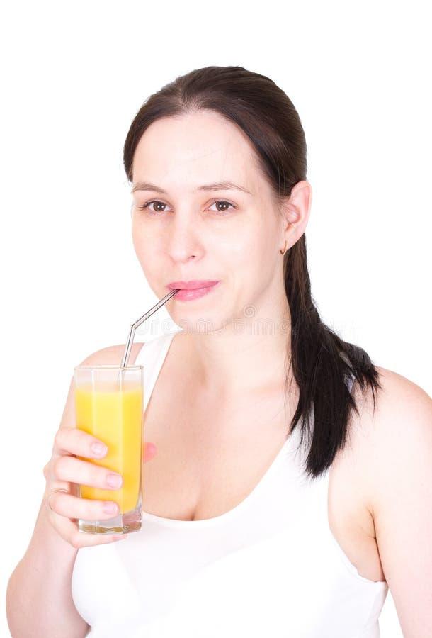 красивейшие выпивая детеныши женщины сока стоковое изображение