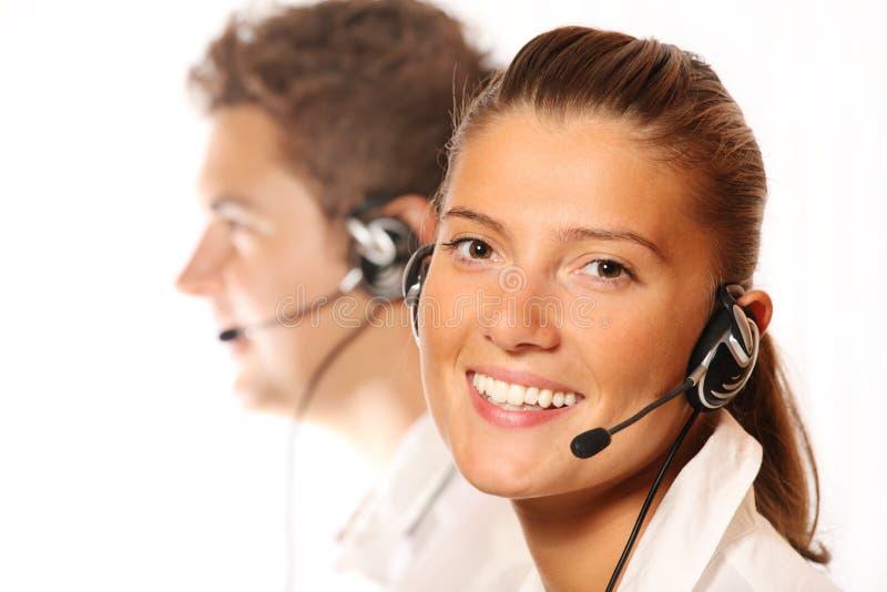 красивейшие детеныши женщины центра телефонного обслуживания стоковое фото rf