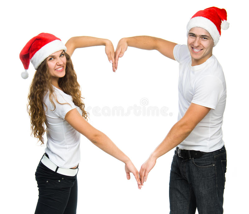 Красивейшие пары Кристмас в шлемах Санты стоковое фото
