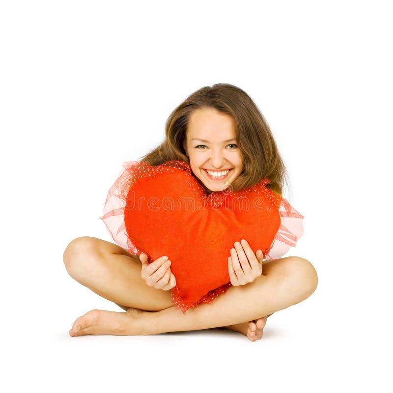 красивейший красный цвет девушки embraces стоковое фото rf