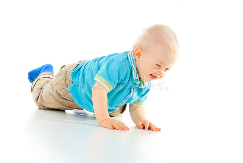Красивейший ребенок вползая на ваших коленях стоковое изображение