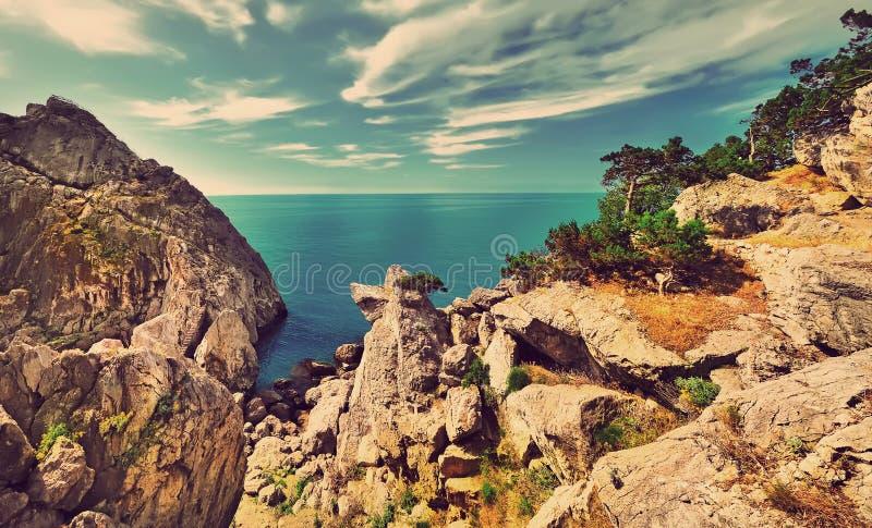 Красивейший Seascape Фильтрованное изображение: влияние обрабатываемое крестом винтажное стоковые изображения
