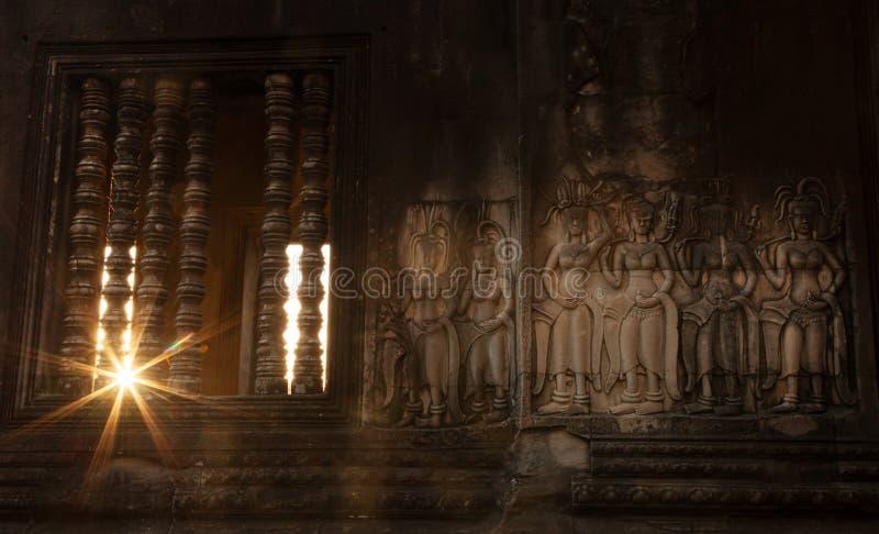 Красивое резное изображение Apsara стоковое фото