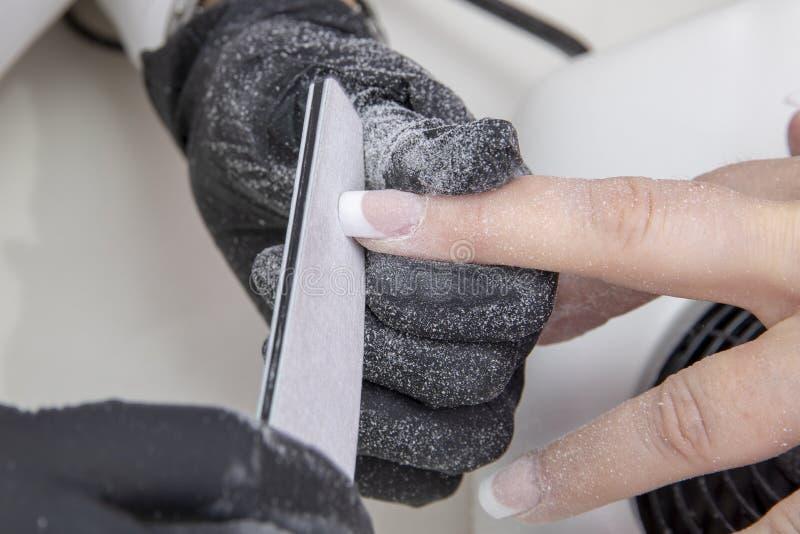 Красиво деланные маникюр ногти стоковое изображение