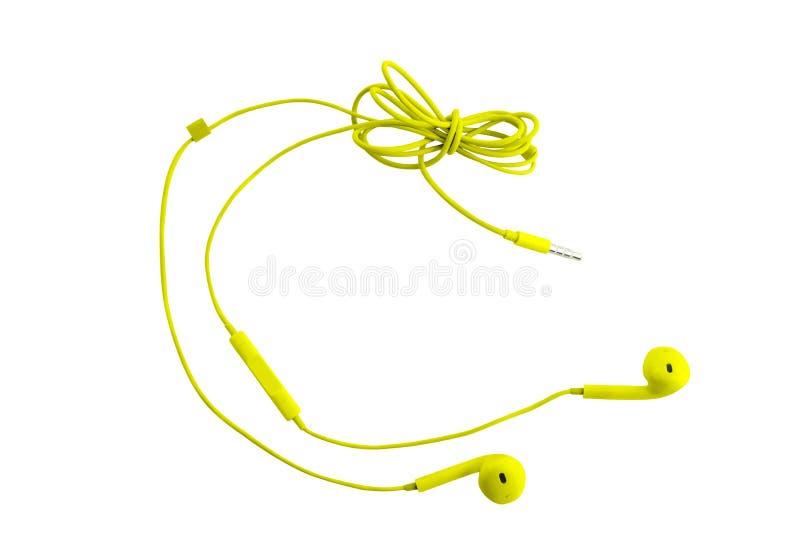 Красивые желтые наушники для смартфонов, планшетов, аудиоплееров и компьютера со шлемофоном, на белой изолированной предпосылке стоковые фото