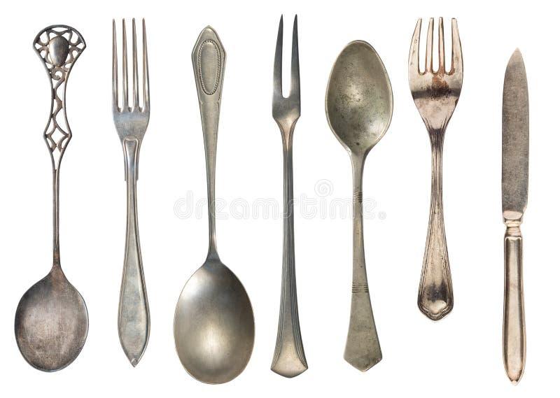Красивые старые винтажные вилки ложки и нож изолированные на белой предпосылке r Ретро silverware стоковое изображение