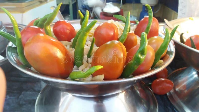 Красивые чили и томат стоковое фото