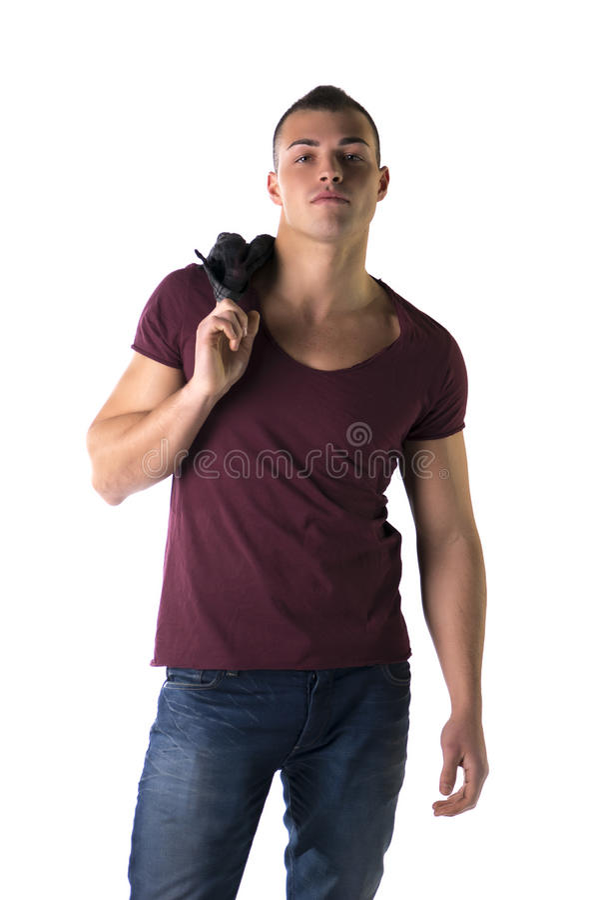 Красивый молодой человек с футболкой и джинсами стоковое фото rf