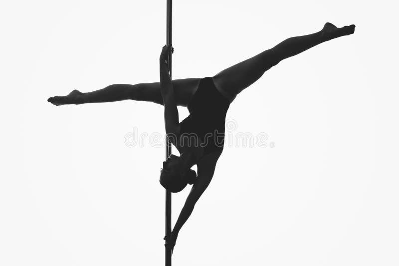 Красивый силуэт девушки танцора поляка стоковые изображения rf