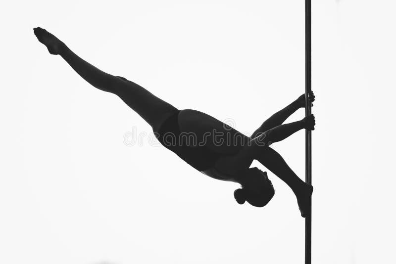 Красивый силуэт девушки танцора поляка стоковое фото rf