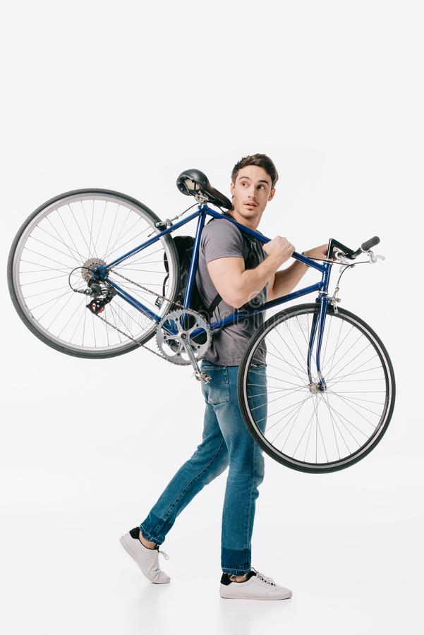 красивый студент держа велосипед на плече стоковое фото rf