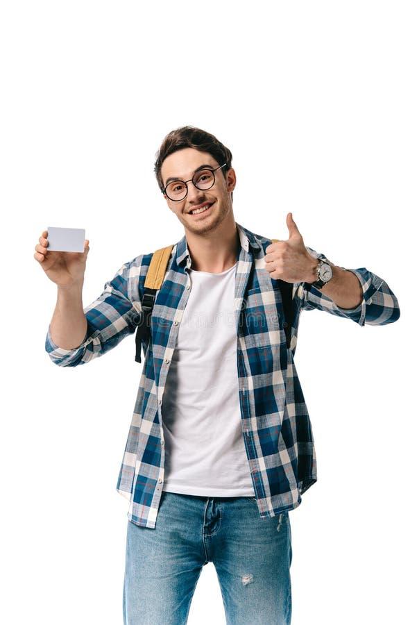 красивый студент держа кредитную карточку и показывая thump вверх стоковая фотография